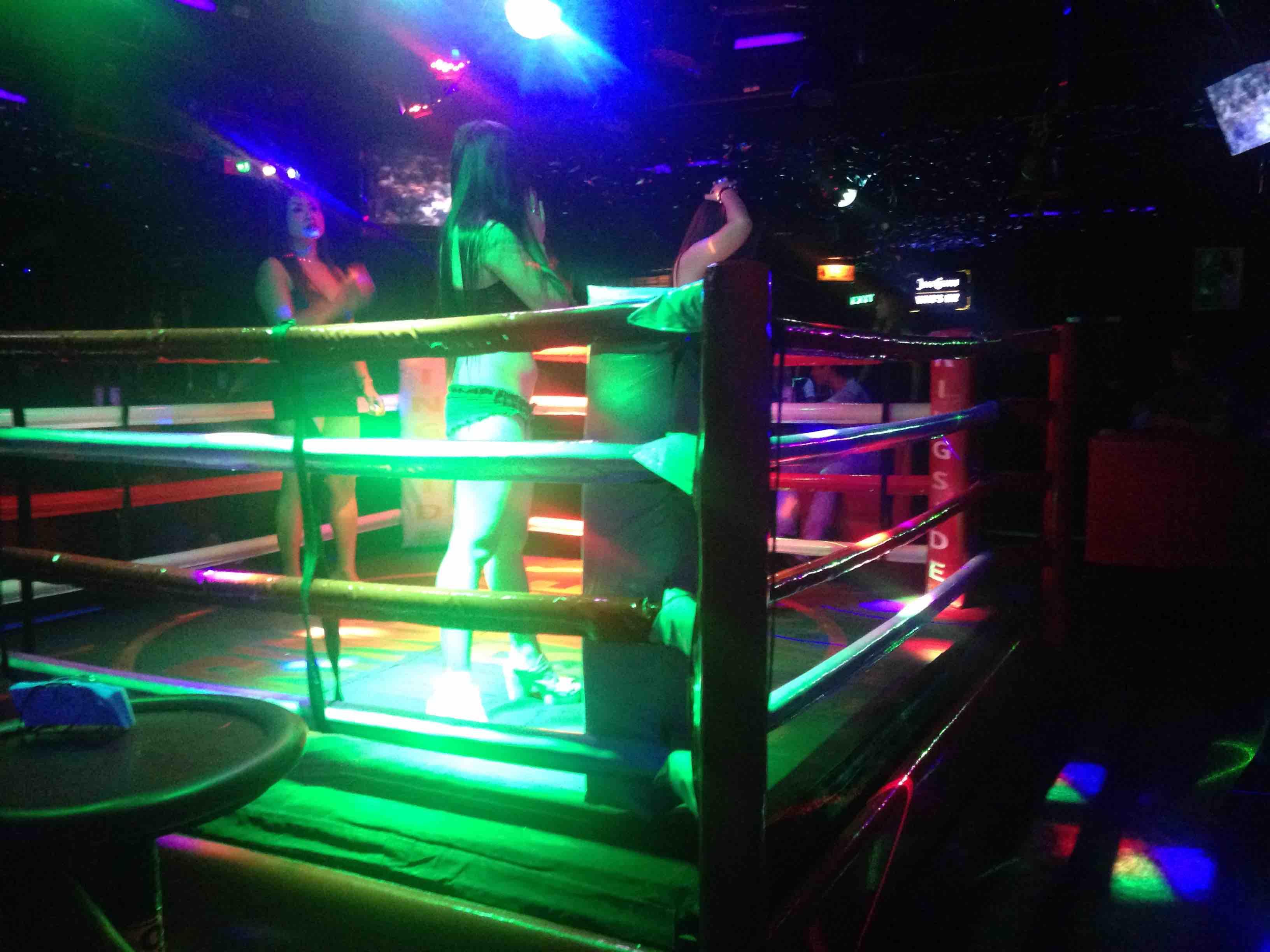 Bored looking girls dance between boxing